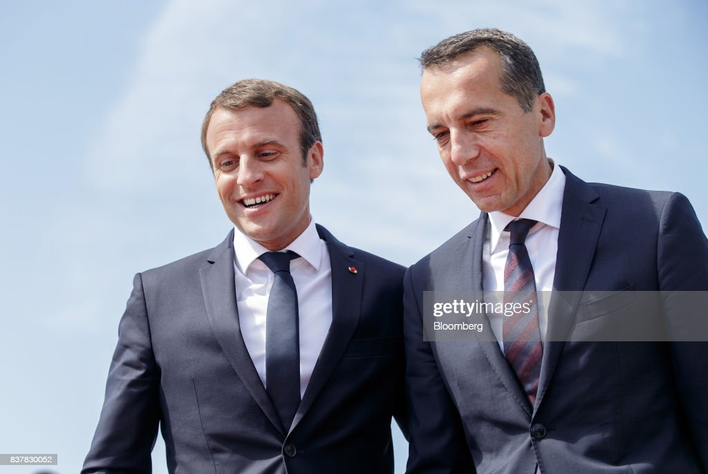 Emmanuel Macron, France's president, left, greets Christian Kern, Austria's chancellor, after arriving at Salzburg Airport in Salzburg, Austria, on Wednesday, Aug. 23, 2017. Macron kicks of a European Union diplomatic blitz Wednesday seeking nothing less than to reshape the blocs stance on subjects ranging from cheap labor to defense and border controls. Photographer: Lisi Niesner/Bloomberg via Getty Images