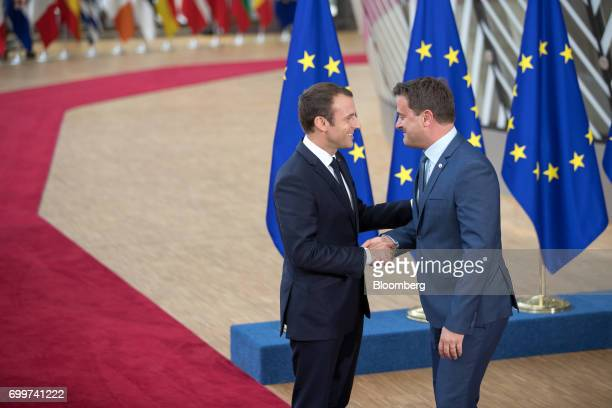 Emmanuel Macron France's president left greets Xavier Bettel Luxembourg's prime minister as he arrives for a European Union leaders summit at the...
