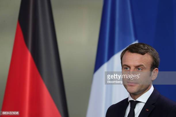 Emmanuel Macron France's president listens during a joint press conference with Angela Merkel Germany's chancellor not pictured in Berlin Germany on...