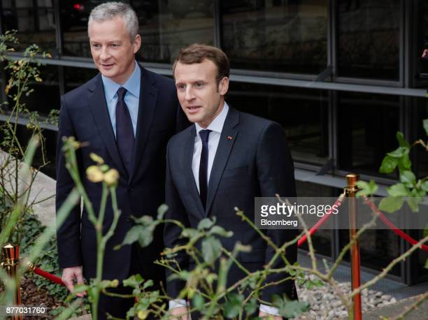 Emmanuel Macron France's president right stands with Bruno Le Maire France's finance minister as he arrives at the Rendezvous de Bercy economic...