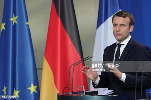 Emmanuel Macron France's president speaks during a joint press conference with Angela Merkel Germany's chancellor not pictured in Berlin Germany on...