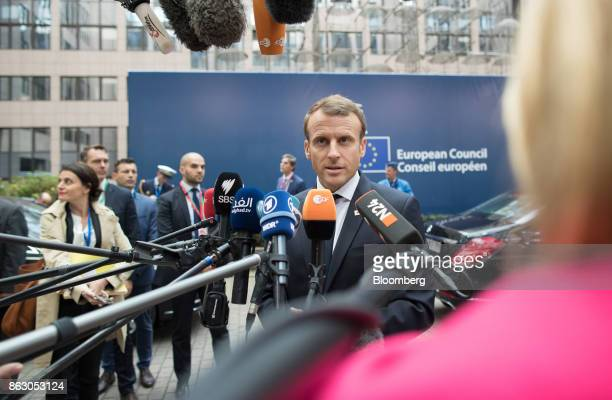 Emmanuel Macron France's president speaks to journalists as he arrives for a meeting of European Union leaders in Brussels Belgium on Thursday Oct 19...