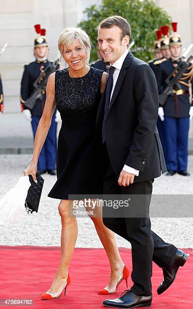 Emmanuel Macron French Minister of Economy and his wife arrive for a dinner with French President Francois Hollande at the Elysee Palace on June 2...