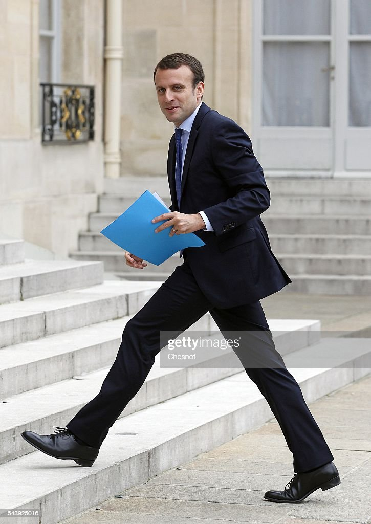 <a gi-track='captionPersonalityLinkClicked' href=/galleries/search?phrase=Emmanuel+Macron&family=editorial&specificpeople=9899223 ng-click='$event.stopPropagation()'>Emmanuel Macron</a>, French Minister of Economy arrives at the Elysee Presidential Palace for a lunch with French President Francois Hollande and leaders of large groups of digital and manufacturers worldwide before the Viva Technology show on June 30, 2016 in Paris, France. Viva Technology Startup Connect, the new international event brings together 5,000 startups with top investors, companies to grow businesses and all players in the digital transformation who shape the future of the internet.