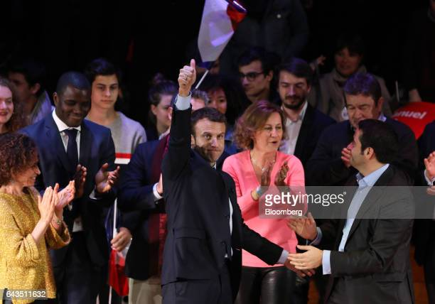 Emmanuel Macron French presidential candidate center gives a thumbsup to attendees after speaking at a campaign meeting with French expatriates at...