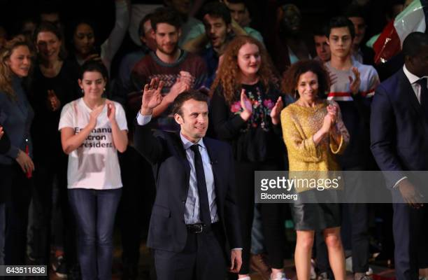 Emmanuel Macron French presidential candidate center waves to attendees after speaking at a campaign meeting with French expatriates at Central Hall...