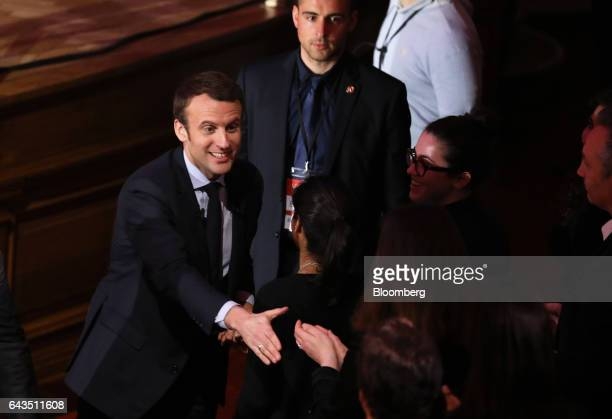 Emmanuel Macron French presidential candidate left greets attendees before speaking at a campaign meeting with French expatriates at Central Hall...