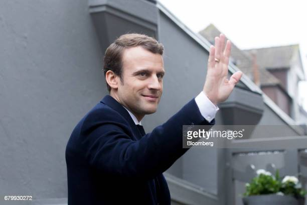 Emmanuel Macron French presidential candidate waves as he arrives at his house after voting during the second round of the French presidential...