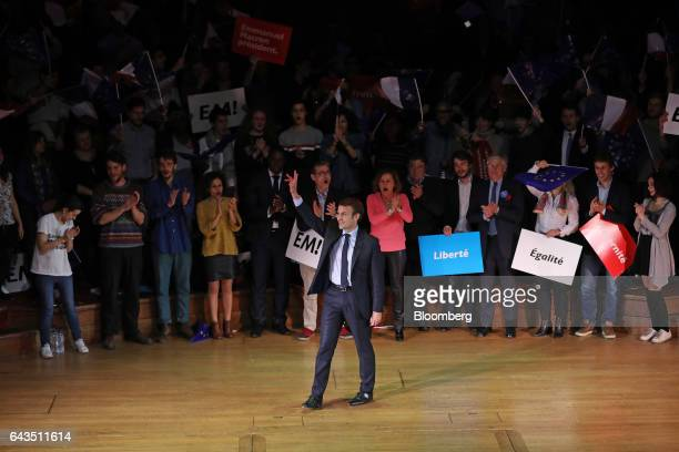 Emmanuel Macron French presidential candidate waves to attendees before speaking at a campaign meeting with French expatriates at Central Hall...