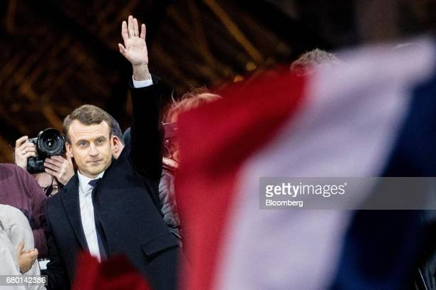 Emmanuel Macron French presidential candidate waves to supporters in front of the Pyramid at the Louvre Museum in Paris France on Sunday May 7 2017...