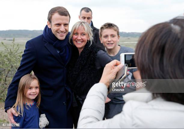 Emmanuel Macron head of the political movement En Marche and candidate for the 2017 presidential election poses with residents of Le Touquet on April...