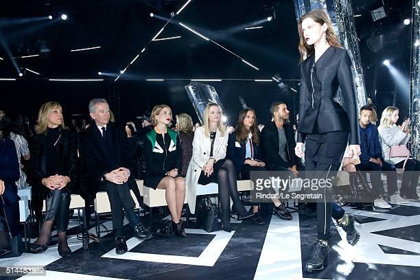 Emmanuel Macron Helene Arnault her husband Owner of LVMH Luxury Group Bernard Arnault Lea Seydoux Louis Vuitton's executive vice president Delphine...
