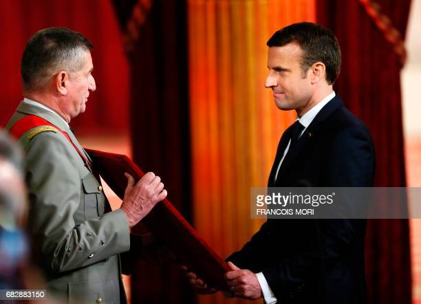 TOPSHOT Emmanuel Macron is presented the great necklace of France's National Order of the Legion of Honour by the great chancellor of the Legion of...