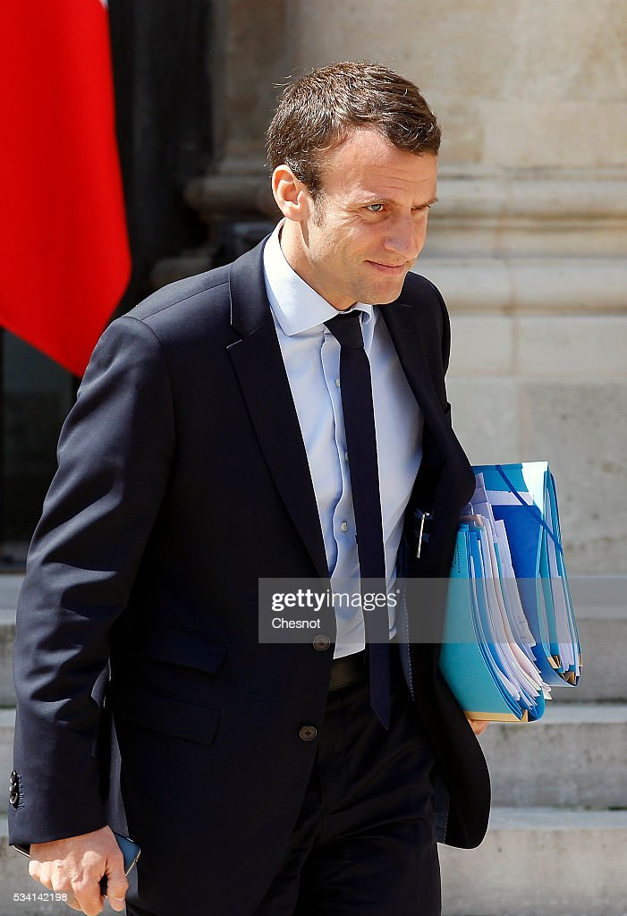 Emmanuel Macron leaves the Elysee Presidential Palace after a weekly cabinet meeting on May 25, 2016 in Paris, France. The French Government confirms that it tapped into its strategic reserves of petroleum products and said the equivalent of three days of inventory of 115 available had been used until now. the French government is facing a serious crisis following the El Khomri law.