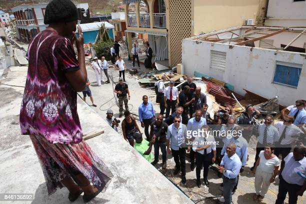 Emmanuel Macron President of France listens to Jane Tim from Guyana during his visit after the passing of Hurricane Irma on September 12 2017 in...