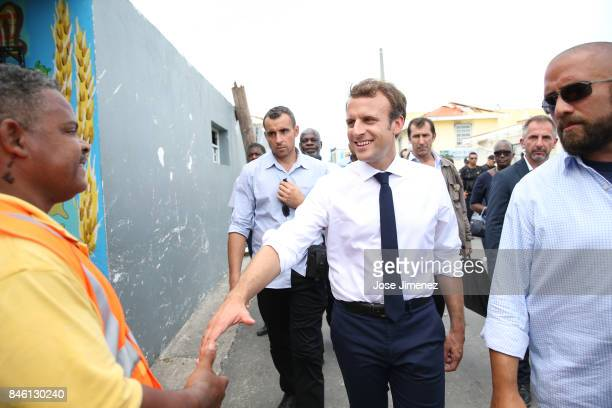 Emmanuel Macron President of France salutes a cleaning personel during his visit to Grande Case on the french side of Saint Martin after passing of...