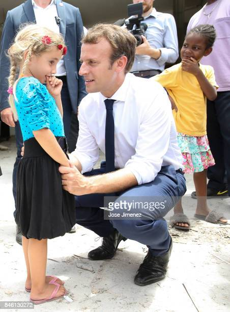 Emmanuel Macron President of France talks to a young girls of Grande Case during his visit after the passing of Hurricane Irma on September 12 2017...