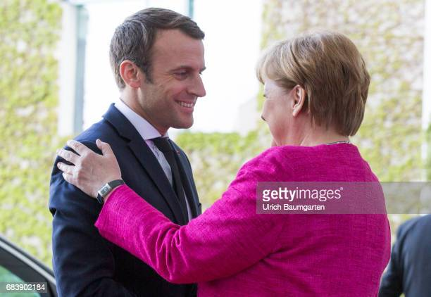 Emmanuel Macron President of the French Republic visiting Berlin Warm welcome by Chancellor Angela Merkel in front of the Federal Chancellery