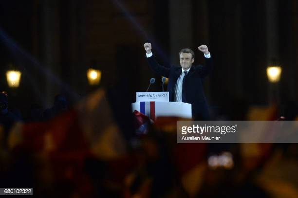 Emmanuel Macron salutes voters after his speech as he celebrates his Presidential election victory At Le Louvre In Paris on May 7 2017 in Paris...