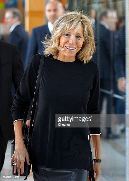 Emmanuel Macron's wife Brigitte Trogneux arrives for the traditional handover ceremony with newly appointed French Economy and Finance Minister...