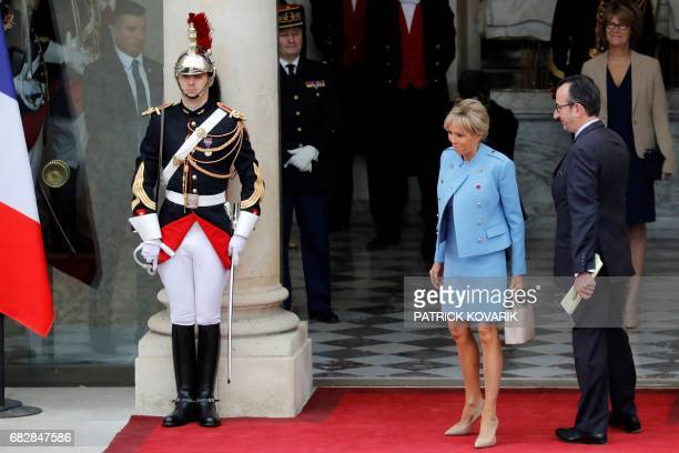 Emmanuel Macron's wife Brigitte Trogneux is welcomed by the Head of Protocol Jose Pietroboni as she arrives at the Elysee presidential Palace to...