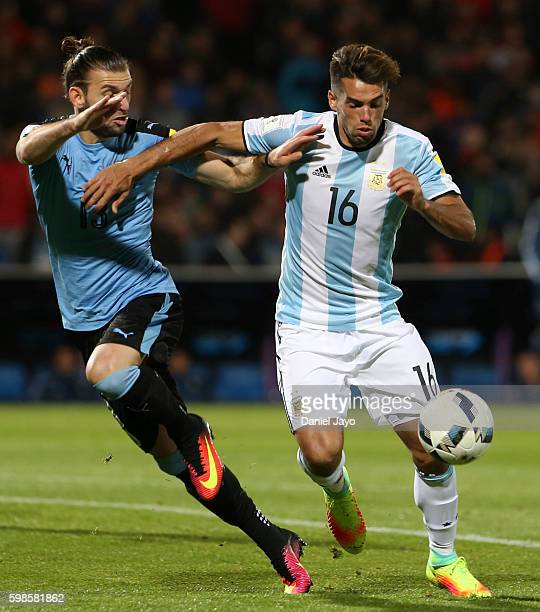 Emmanuel Mas of Argentina and Gaston Silva of Uruguay battle for the ball during a match between Argentina and Uruguay as part of FIFA 2018 World Cup...