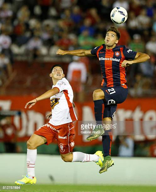 Emmanuel Mas of San Lorenzo fights for the ball with Cristian Espinoza of Huracan during a fifth round match between Huracan and San Lorenzo as part...