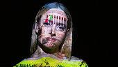 Emmanuel Monument image on a woman's face.