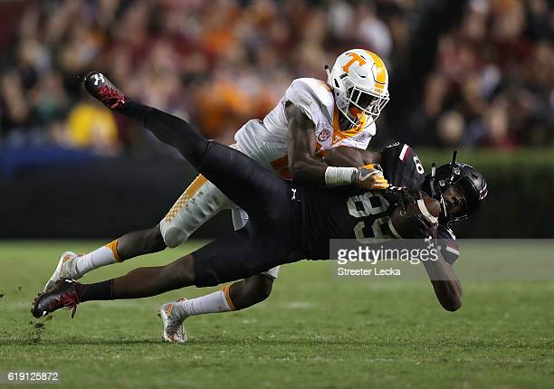 Emmanuel Moseley of the Tennessee Volunteers tackles Bryan Edwards of the South Carolina Gamecocks after a catch during their game at WilliamsBrice...