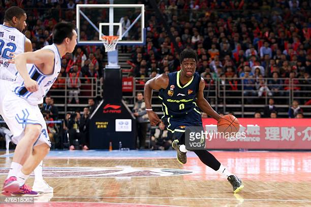 Emmanuel Mudiay of Guangdong Southern Tigers in action during the CBA 14/15 semifinal game against Beijing Ducks on March 3 2015 in Beijing China