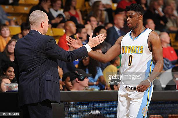 Emmanuel Mudiay of the Denver Nuggets and head coach Michael Malone of the Denver Nuggets shakes hands during a preseason game against the Chicago...