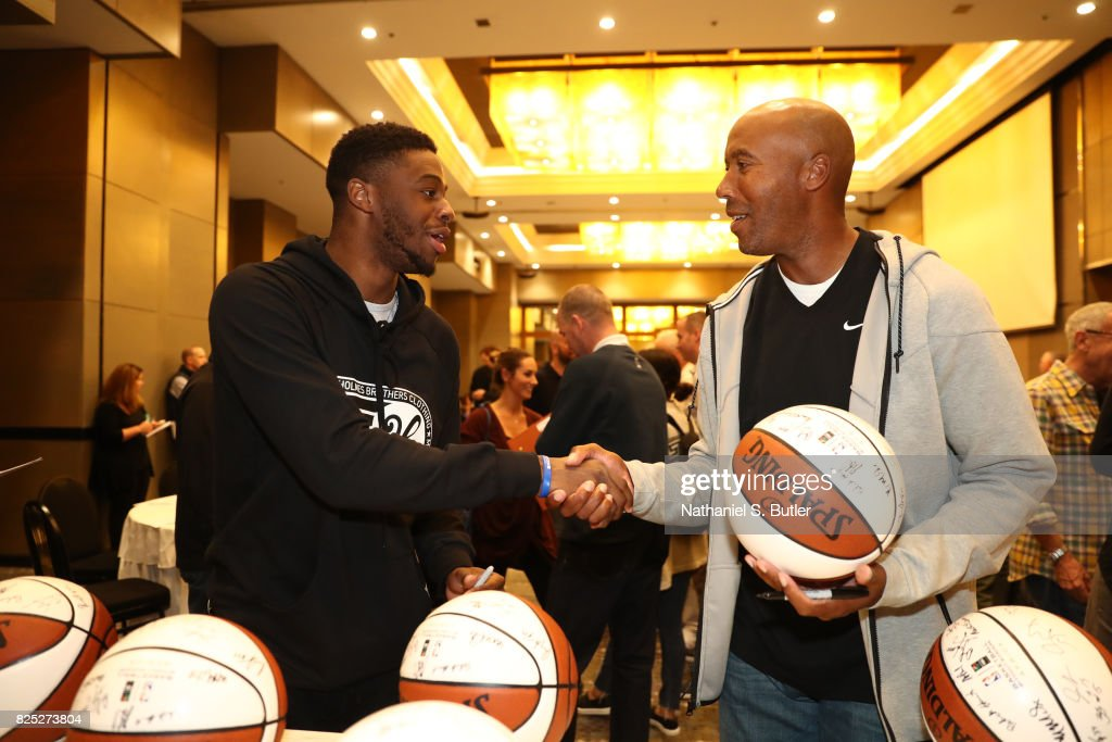 Emmanuel Mudiay of the Denver Nuggets and NBA Legend Bruce Bowen chats during the Basketball Without Borders Africa program at the Hyatt Regency Hotel on August 1, 2017 in Gauteng province of Johannesburg, South Africa.