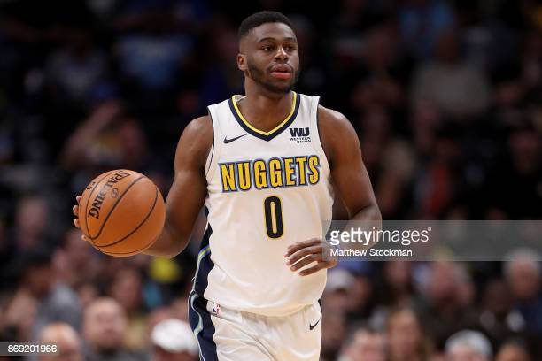 Emmanuel Mudiay of the Denver Nuggets brings the ball down the court against the Toronto Raptor at the Pepsi Center on November 1 2017 in Denver...