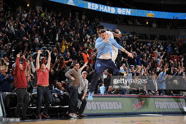 Emmanuel Mudiay of the Denver Nuggets celebrates with Mike Miller of the Denver Nuggets after hitting the game winning three point shot against the...
