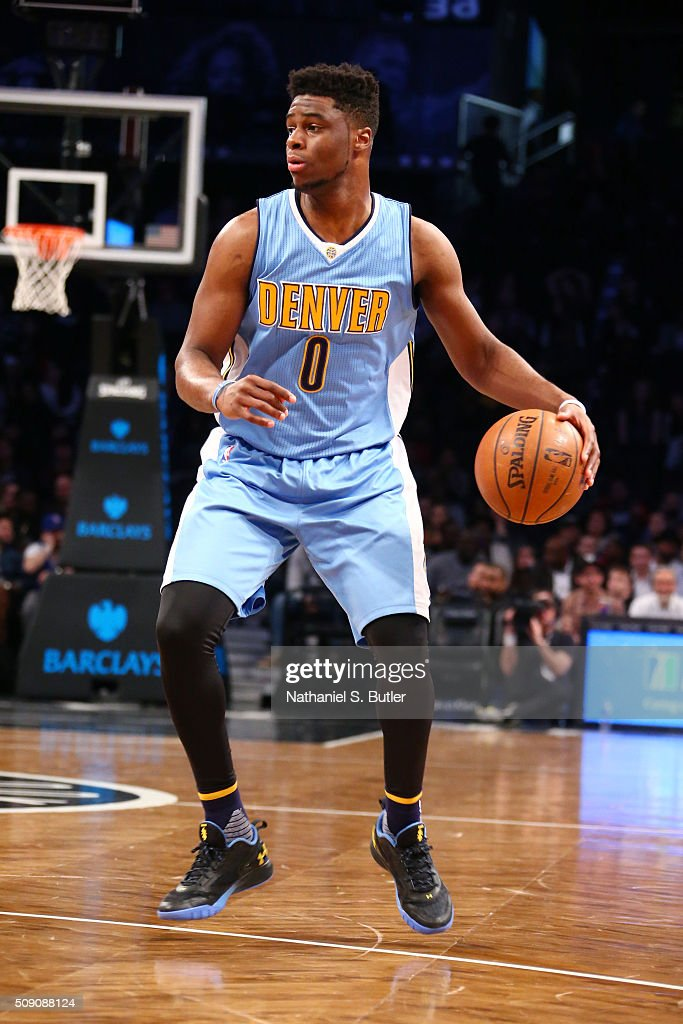 <a gi-track='captionPersonalityLinkClicked' href=/galleries/search?phrase=Emmanuel+Mudiay&family=editorial&specificpeople=9510824 ng-click='$event.stopPropagation()'>Emmanuel Mudiay</a> #0 of the Denver Nuggets defends the ball against the Brooklyn Nets during the game on February 8, 2016 at Barclays Center in Brooklyn, New York.
