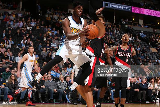Emmanuel Mudiay of the Denver Nuggets dishes the ball off against Meyers Leonard of the Portland Trail Blazers at Pepsi Center on November 9 2015 in...