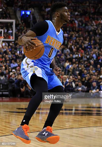 Emmanuel Mudiay of the Denver Nuggets dribbles the ball during the first half of an NBA game against the Toronto Raptors at Air Canada Centre on...