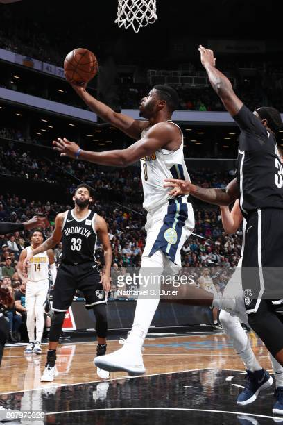 Emmanuel Mudiay of the Denver Nuggets drives to the basket against the Brooklyn Nets on October 29 2017 at Barclays Center in Brooklyn New York NOTE...