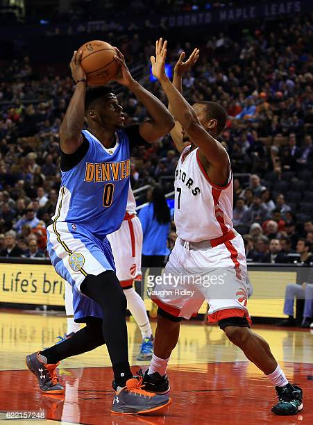 Emmanuel Mudiay of the Denver Nuggets drives to the basket during the first half of an NBA game against the Toronto Raptors at Air Canada Centre on...