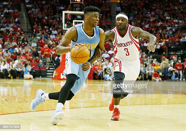 Emmanuel Mudiay of the Denver Nuggets drives with the basketball against Ty Lawson of the Houston Rockets during their game at the Toyota Center on...