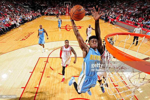 Emmanuel Mudiay of the Denver Nuggets dunks the ball against the Houston Rockets on October 28 2015 at the Toyota Center in Houston Texas NOTE TO...