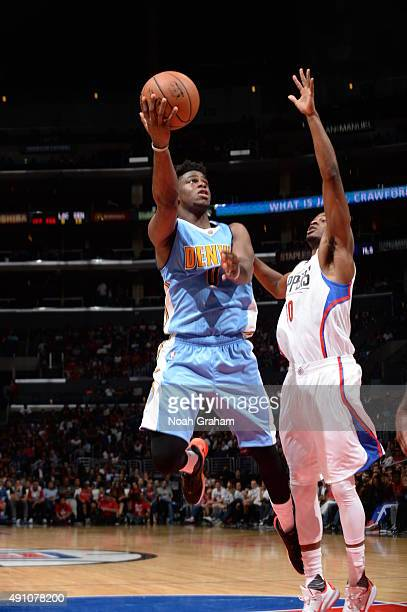 Emmanuel Mudiay of the Denver Nuggets goes to the basket against the Los Angeles Clippers during a preseason game on October 2 2015 at STAPLES Center...