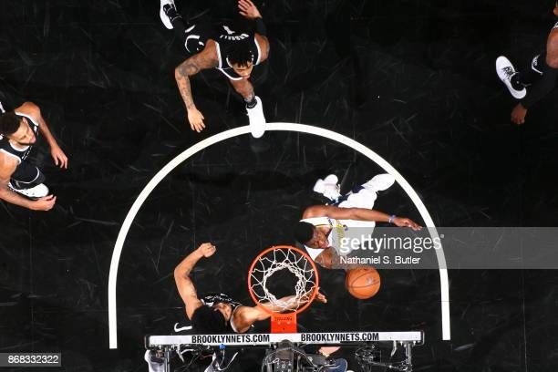 Emmanuel Mudiay of the Denver Nuggets goes to the basket against the Brooklyn Nets on October 29 2017 at Barclays Center in Brooklyn New York NOTE TO...