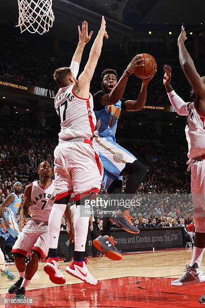 Emmanuel Mudiay of the Denver Nuggets goes up for a lay up against Jonas Valanciunas of the Toronto Raptors during a game on October 31 2016 at the...
