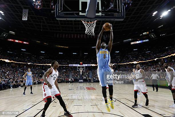 Emmanuel Mudiay of the Denver Nuggets grabs the rebound against the Toronto Raptors on October 3 2016 at the Scotiabank Saddledome in Calagary...