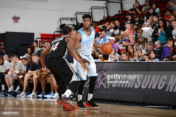 Emmanuel Mudiay of the Denver Nuggets handles the ball against the Miami Heat on July 13 2015 at The Cox Pavilion in Las Vegas Nevada NOTE TO USER...