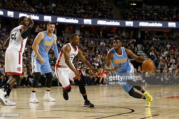 Emmanuel Mudiay of the Denver Nuggets handles the ball against the Toronto Raptors on October 3 2016 at the Scotiabank Saddledome in Calagary Alberta...