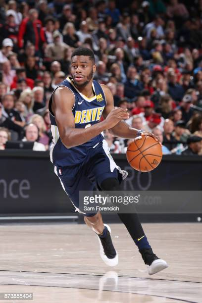 Emmanuel Mudiay of the Denver Nuggets handles the ball against the Portland Trail Blazers on November 13 2017 at the Moda Center in Portland Oregon...