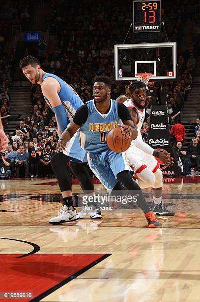 Emmanuel Mudiay of the Denver Nuggets handles the ball during a game against the Toronto Raptors on October 31 2016 at the Air Canada Centre in...