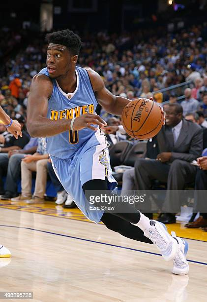 Emmanuel Mudiay of the Denver Nuggets in action against the Golden State Warriors at ORACLE Arena on October 13 2015 in Oakland California NOTE TO...